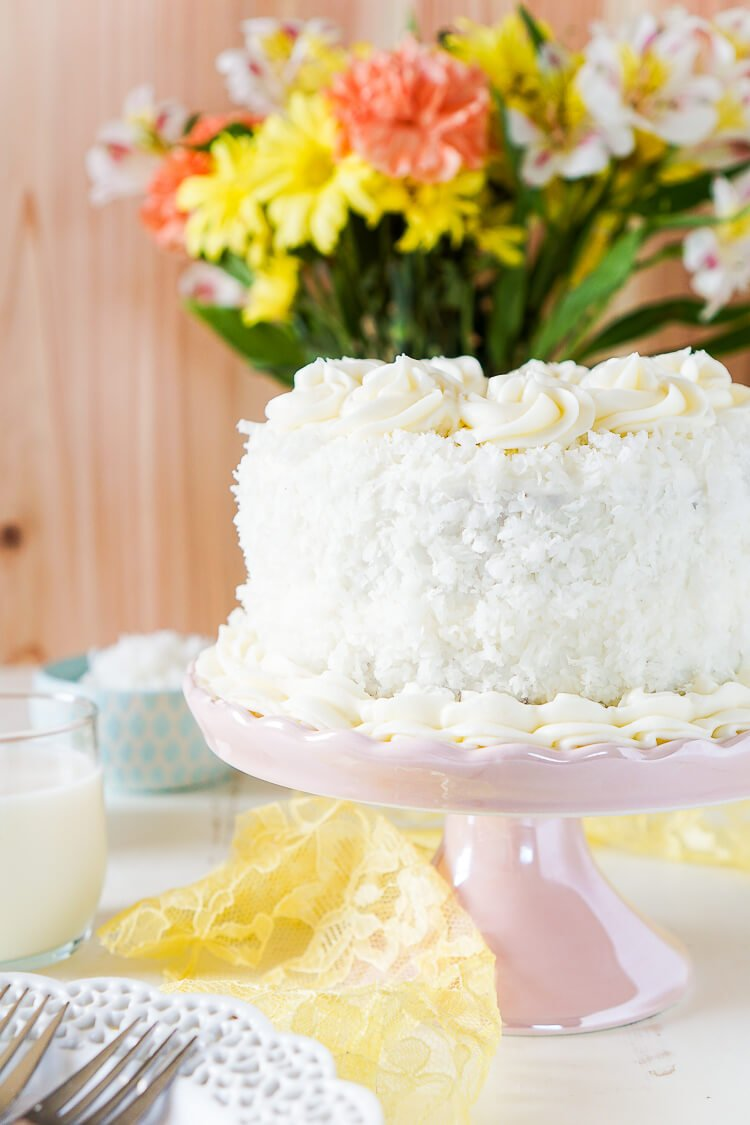 This Classic Coconut Cake is the perfect Easter dessert! Light and fluffy with a cream cheese frosting laced with the essence of sweet coconut!