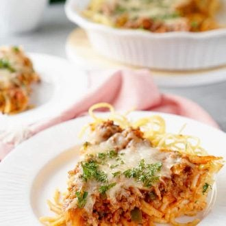 Baked Spaghetti Pie is an easy and delicious dinner recipe. Al dente spaghetti topped with meat sauce and layer of melty cheese.
