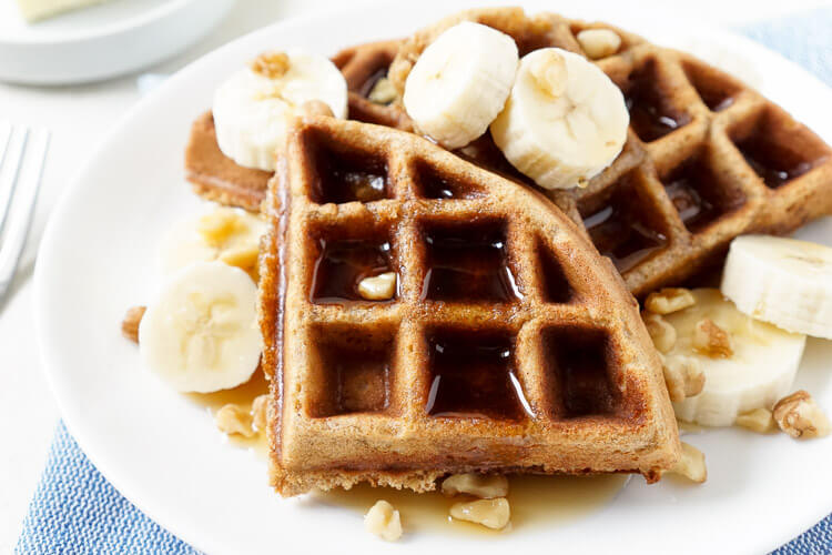 These Whole-Wheat Banana Nut Bread Waffles are the perfect way to start your day! Fluffy Belgian waffles laced with mashed bananas and loaded with nuts for a hearty and sweet breakfast that's ready in minutes!