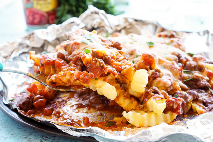 These Grilled Chili Cheese Fries are a quick and easy summer dish the whole family will love!