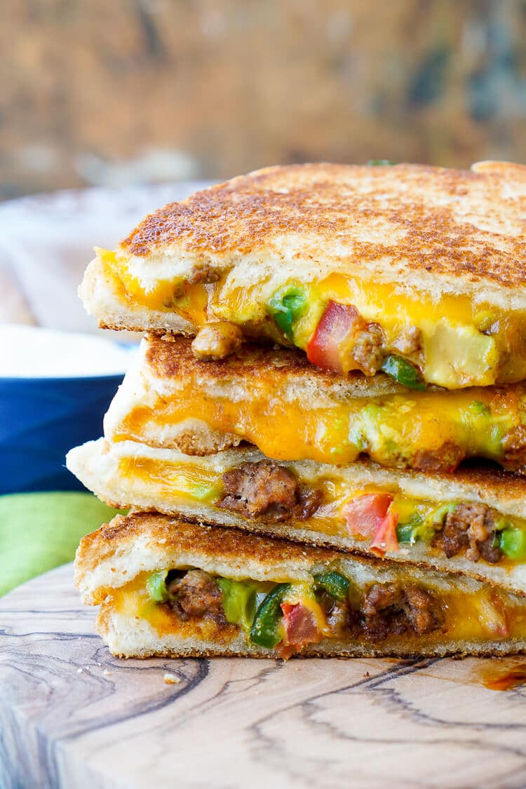 This Taco Grilled Cheese Sandwich can be customized just like a taco! The original recipe is packed with bold flavor and a little heat for a lunch or dinner that's sure to leave your mouth watering!