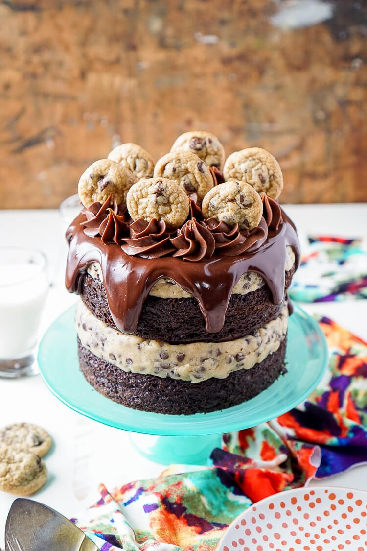 This Chocolate Chip Cookie Dough Cake is made with two layers of delicious chocolate cake and two layers of edible cookie dough then topped with ganache, frosting and mini chocolate chip cookies!