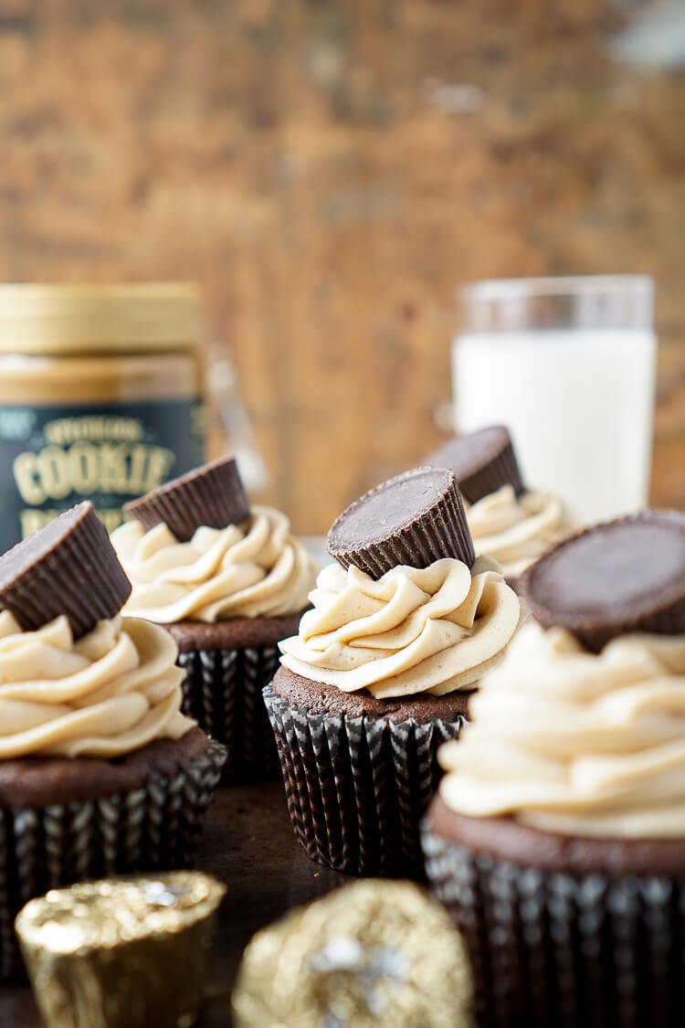 These Cookie Butter Chocolate Cupcakes are rich, sweet, and easy to make! An adapted cake box mix makes up the moist cupcakes and then they're topped with a silky smooth cookie butter frosting and a cookie butter cup!