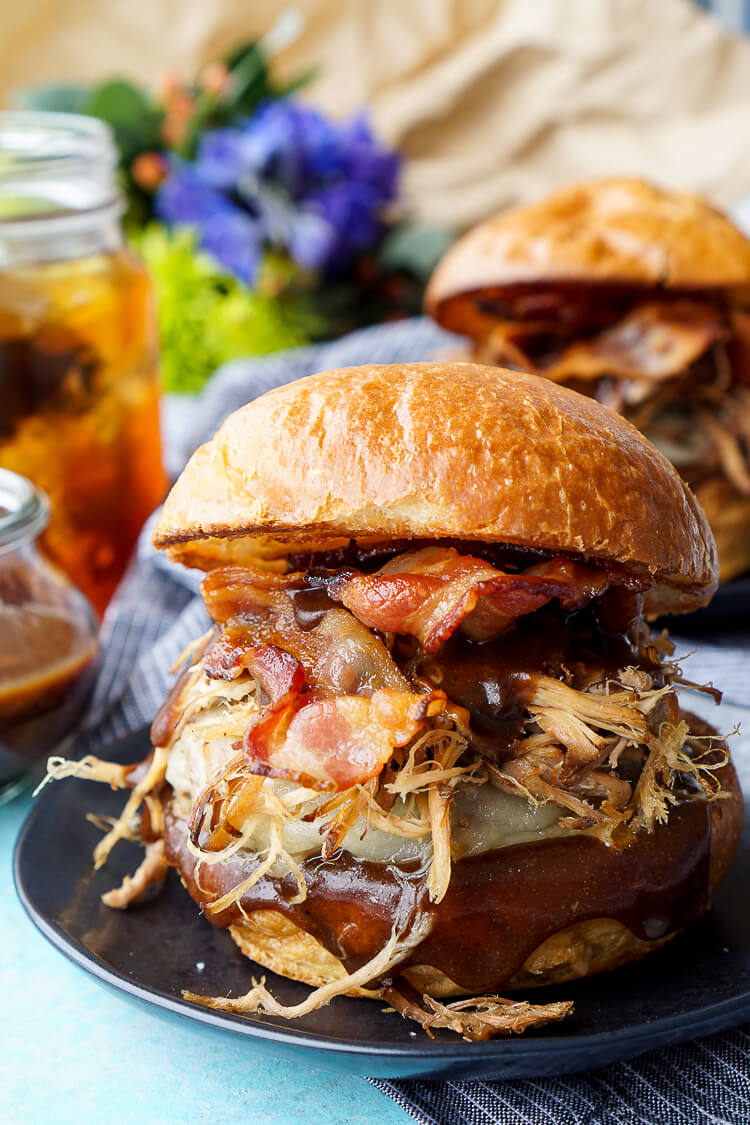 This Meat Lovers Cheeseburger is loaded up with a burger, pulled pork, and bacon! Topped with cheese and a sweet and tangy sauce, it's the ultimate burger!