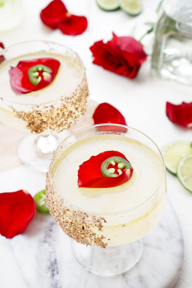 This Rosa Picante Margarita is the Patrón Margarita of the Year! Expertly crafted, artfully presented, and it tastes as smooth as it looks! A mix of tequila, lime juice, rosewater, ginger syrup, and jalapeno oil make for a refined spicy cocktail that will knock your socks off!