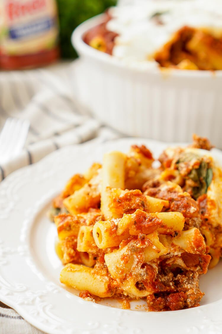This Baked Ziti is a classic homestyle dish that's just waiting to be devoured! Tender pasta, melted cheese, meat, and a hearty sauce come together for the ultimate comfort food!