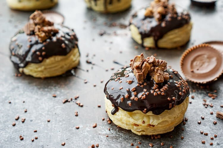 These Reese's Stuffed Puff Pastry Donuts are rich, decadent, and easy to make! Just 6 ingredients stand between you and chocolate-peanut butter bliss!