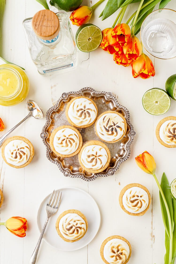 These Tequila Lime Cookie Tarts are a boozy twist on a classic dessert. Welcome summer and warm weather with this mini dessert that's sure to be a party favorite!
