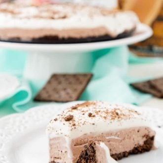 This Skinny Ice Cream Cake is everything you love about the classic dessert, but lighter! A layer of chocolate graham cracker is topped with a creamy chocolate center and topped with whipped topping for a cold summer treat everyone will love!