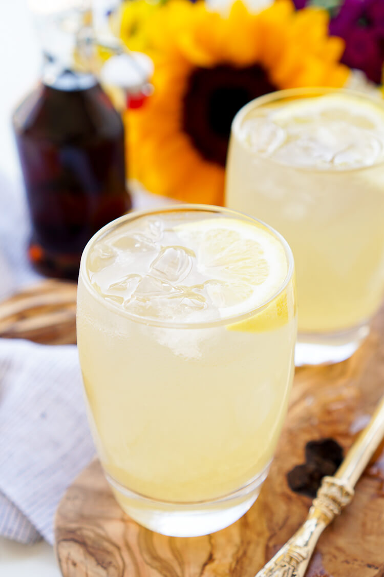 This Maple Lemonade is inspired by Maine and made with just lemon juice, maple syrup, and water. It's a refreshing cold drink for summer or fall!