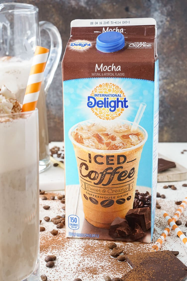 This Mocha Coffee Punch is bound to be a new party favorite by hosts and guests alike! It's easy to make and tastes amazingly creamy and delicious! Made with mocha iced coffee, sugar, milk, and vanilla ice cream, you'll love the fresh new take on the traditional party punch!