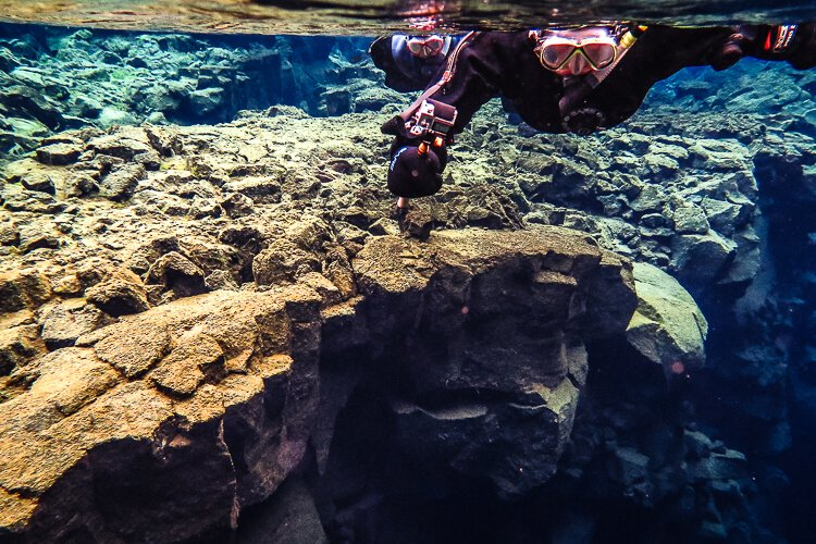 Planning a trip to Iceland? Make sure Snorkeling Between Continents in Silfra is on your list! It's a crazy-amazing experience you won't forget!