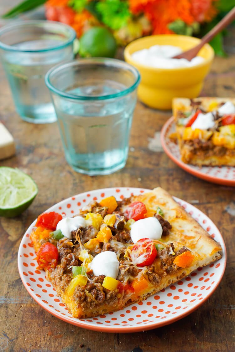 Mix up your Taco Tuesday menu with this Taco Pizza, it's everything you love about the classic weeknight meal on a delicious flatbread for a quick and easy dinner idea the whole family will love!