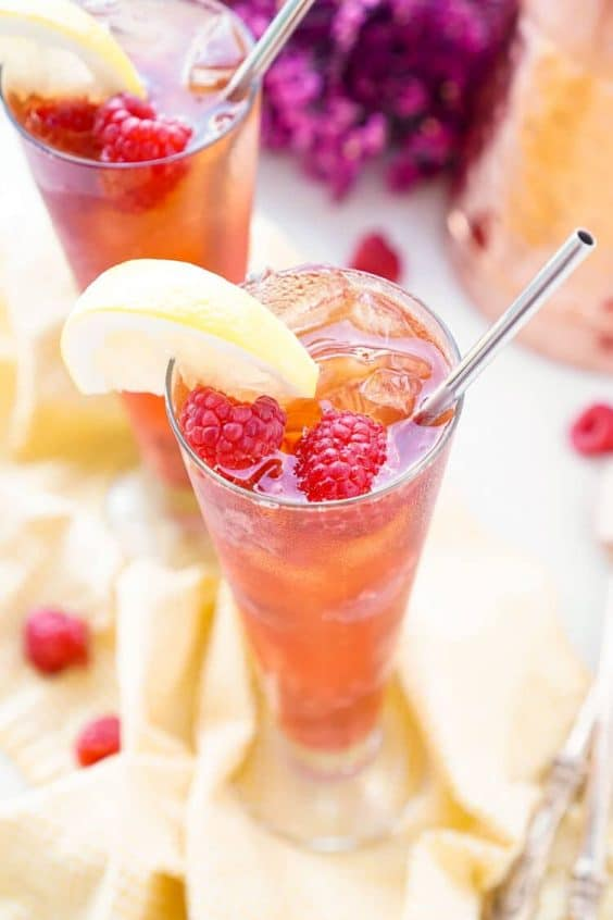This Easy Raspberry Iced Tea recipe is a refreshingly sweet drink you'll want to sip all summer long! Made with just 4 ingredients, you can have a large party pitcher ready with only 10 minutes of work.