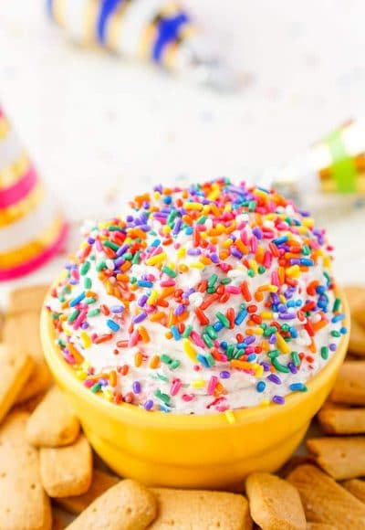 This Funfetti Birthday Cake Dip is perfect for serving up at parties or enjoying by yourself when a craving strikes! Ready in just 5 minutes and made with cake mix, cream cheese, cool whip, and rainbow sprinkles!