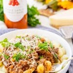 This Gnocchi Bolognese is a rich and delicious meal. A great Italian dinner option for weeknights or Sunday supper that's loaded with tender gnocchi and a hearty meat sauce laced with red wine, onions, and garlic.