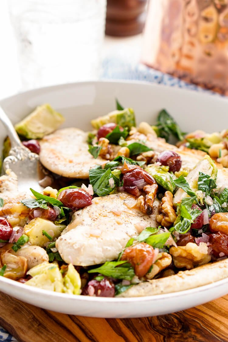 This Chicken Dinner is loaded with seasonal flavors and comes together in just 30 minutes! Roasted Brussels sprouts and red grapes mixed with shallots and garlic and the crunch of walnuts bring this whole meal to life!