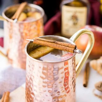 This Crock Pot Apple Cider will make entertaining a breeze this holiday season! Seasoned with cinnamon, apples, and ginger, this cider can simmer in the crock all night long! Keep the spiced rum on the side so guests have a boozy and non-alcoholic option!