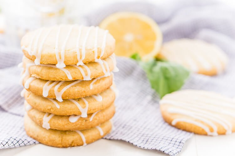 These Lemon Basil Shortbread Cookies will melt in your mouth, they're rich, sweet, and flaky. Made with butter, confectioners' sugar, flour, lemon zest, basil, and salt, they're perfect for tea, parties, or snacking!