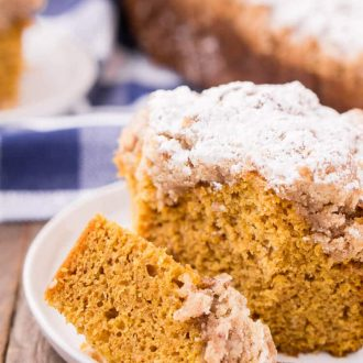 This Vanilla Pumpkin Coffee Cake is light and fluffy with a spicy butter crumble on top! It's easy to make and a great way to kick start your fall morning!
