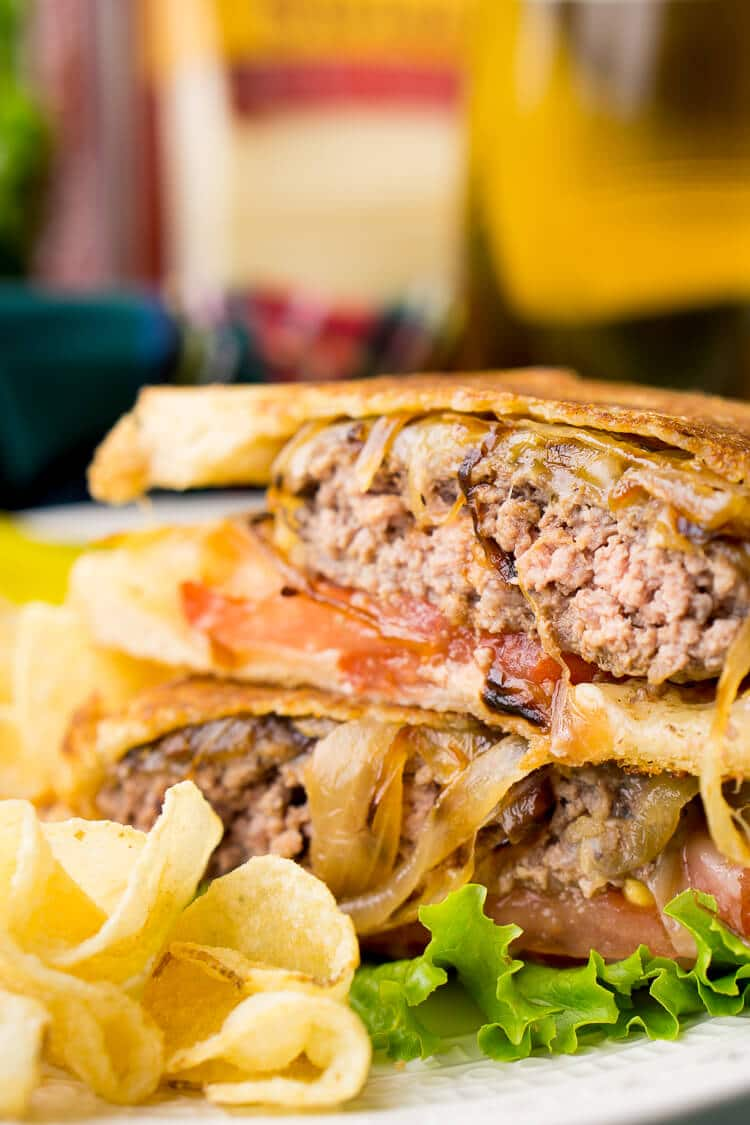 A Classic Patty Melt is a comfort food staple - a juicy burger with Swiss cheese, caramelized onions, and bread - and there's no reason you can't make delicious ones right at home!