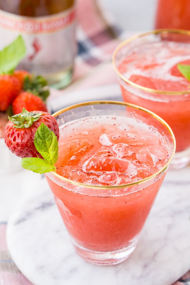 this strawberry champagne punch is the ultimate pink drink its sparkly easy to make