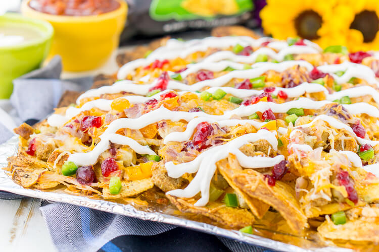 These Thanksgiving Leftover Nachos are a great use for all that extra food sitting in your fridge after that big Turkey Day meal! You'll love how the cozy flavors of Thanksgiving are topped off with a little spice and tortilla chips for a meal or snack that's perfect for a weekend of binge-watching tv!