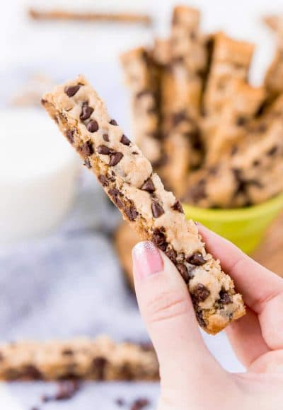 These Chocolate Chip Cookie Sticks are perfect for dunking! A thick, slightly crisp, yet still chewy cookie loaded with mini chocolate chips and made in a 9 x 13-inch pan for easy baking!