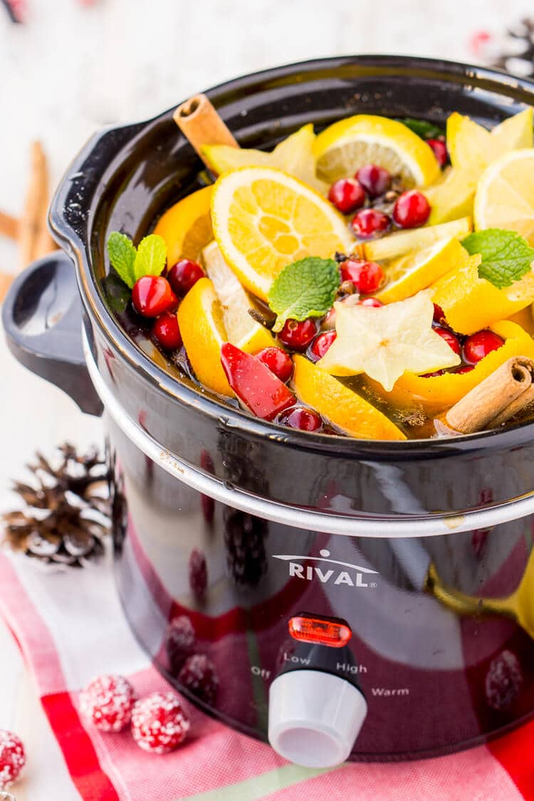 This DIY Holiday Crock Pot Potpourri will have your house smelling amazing all season long with sweet and spicy aromas of cranberries, oranges, mint, cloves, cinnamon, and more!