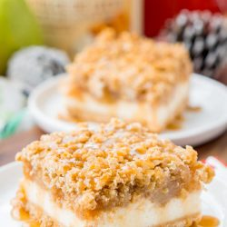 Close up photo of a pear cheesecake bar on a white plate.