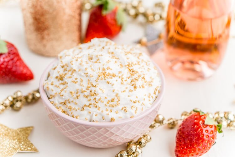 3-Ingredient Champagne Cake Dip is an easy no-bake dessert to whip together for New Year's Eve, Valentine's Day, or bridal showers. Perfect for dipping strawberries, graham crackers, and pretzels!