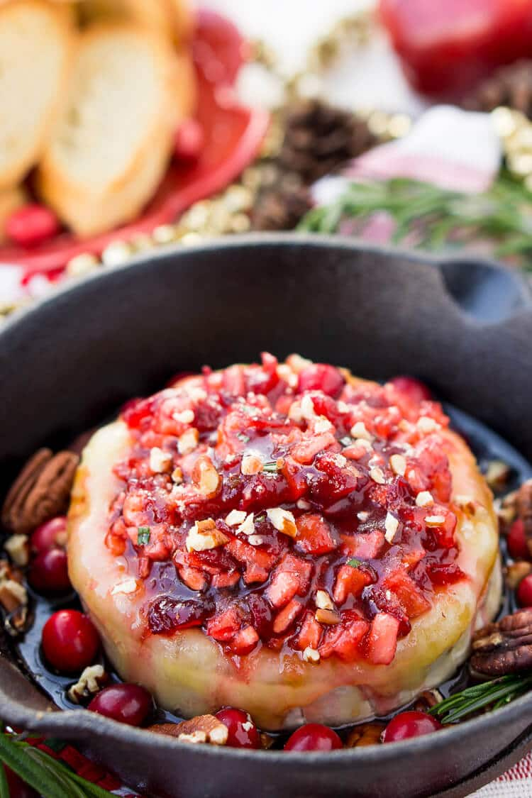 Apple Cranberry Baked Brie is a delicious cheese appetizer loaded with brown sugar, maple syrup, pecans, and an apple cranberry compote.