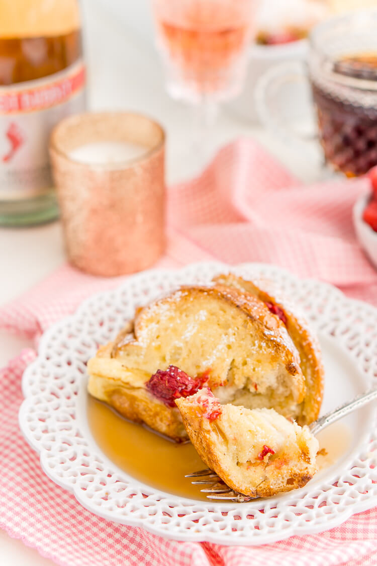 Champagne Raspberry Baked French Toast is the perfect way to kick off the New Year, Valentine's Day, or an anniversary! Prep it the night before so all you have to do is bake it in the morning!