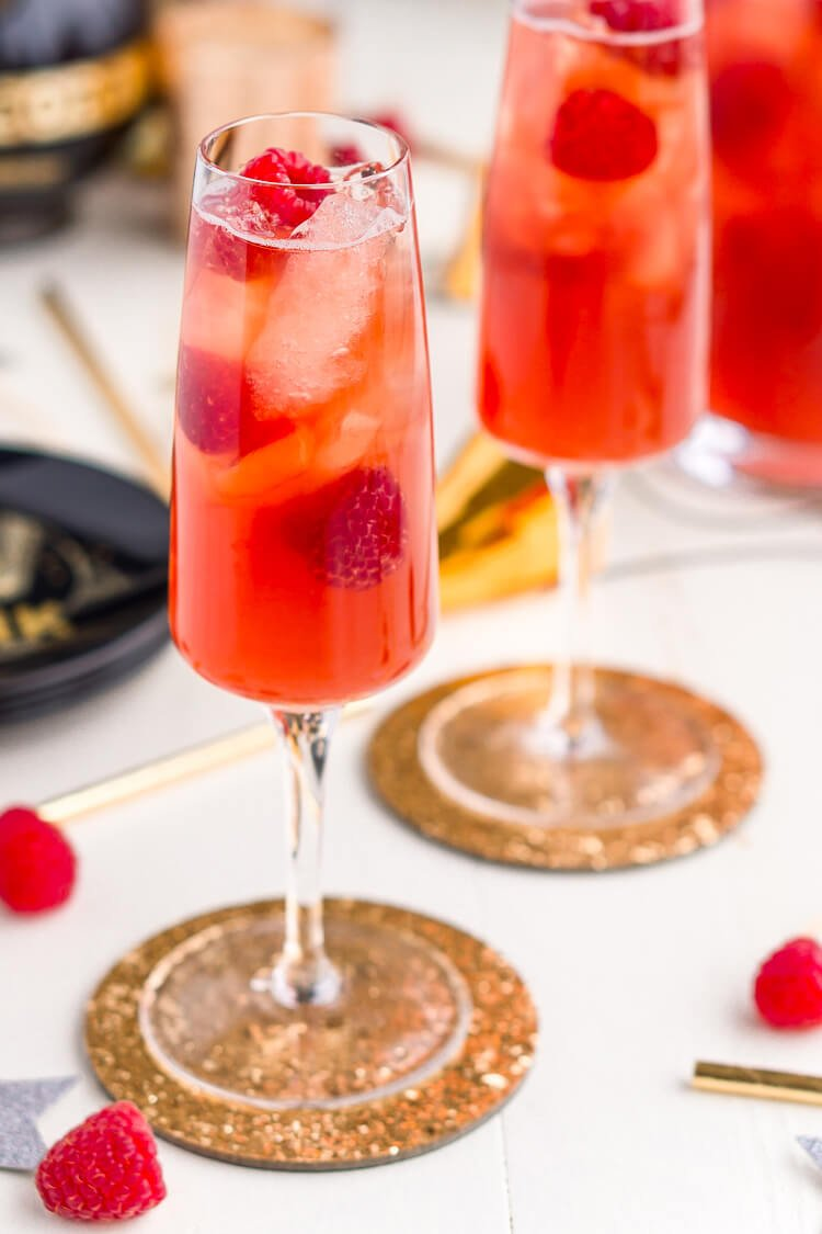 New Year's Eve Champagne Punch made Triple Sec, blackberry brandy, Chambord, pineapple juice, ginger ale, and champagne.