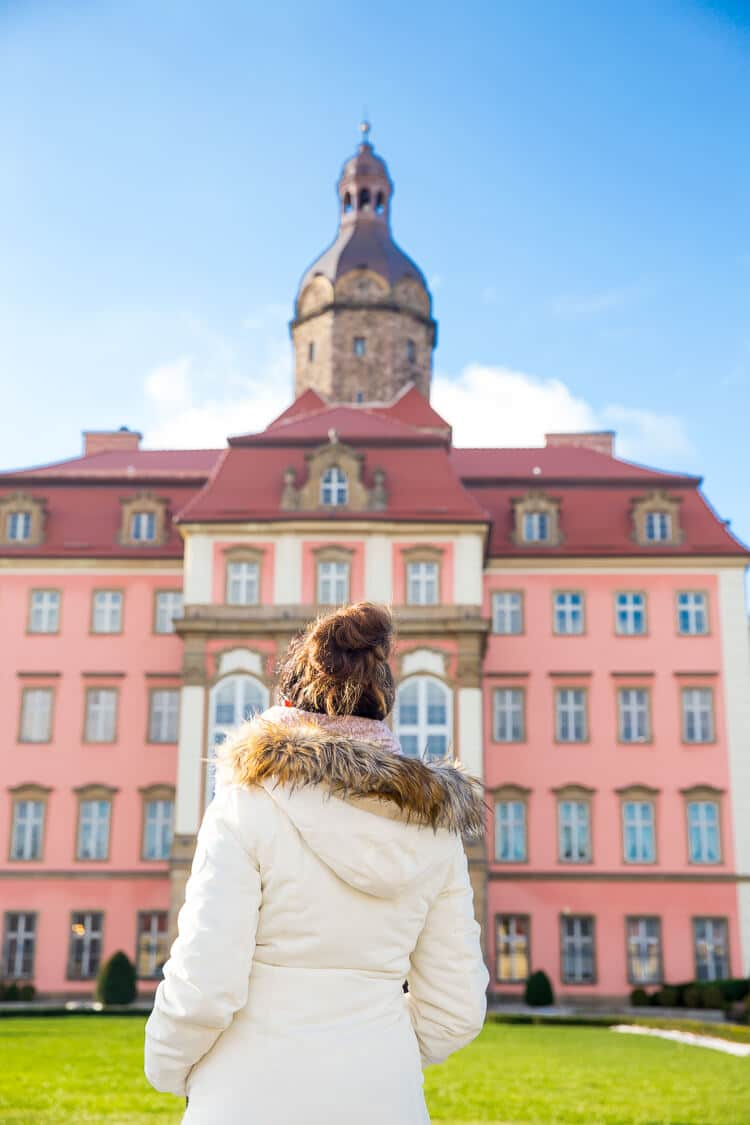 Ksiaz Castle & Hotel in Poland is a charming castle with budget-friendly accommodations nestled in the hills and mountains of Poland. Stay the night, explore the maze of corridors, and take in the gorgeous grounds while you're there!