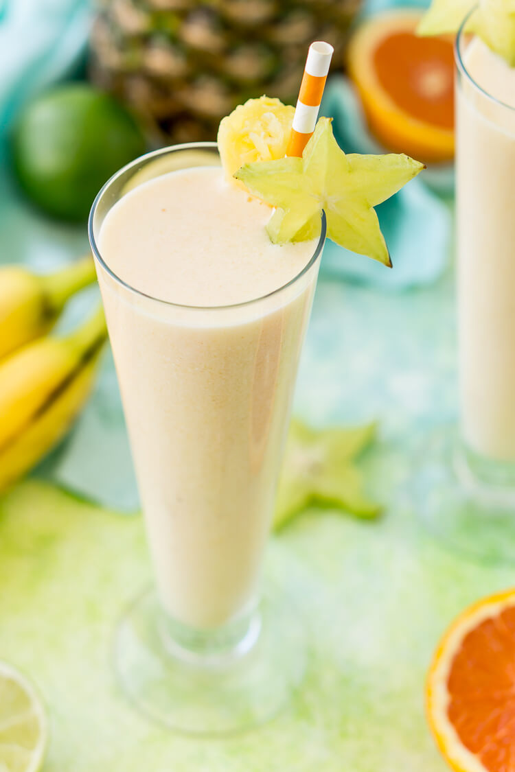 Tropical Smoothie made with orange, bananas, coconut, and pineapple.