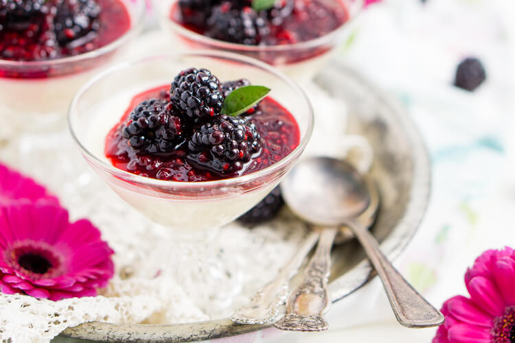 Blackberry Buttermilk Panna Cotta is a delicious Southern twist on a classic Italian dessert. A sweet panna cotta topped with a bold blackberry sauce.