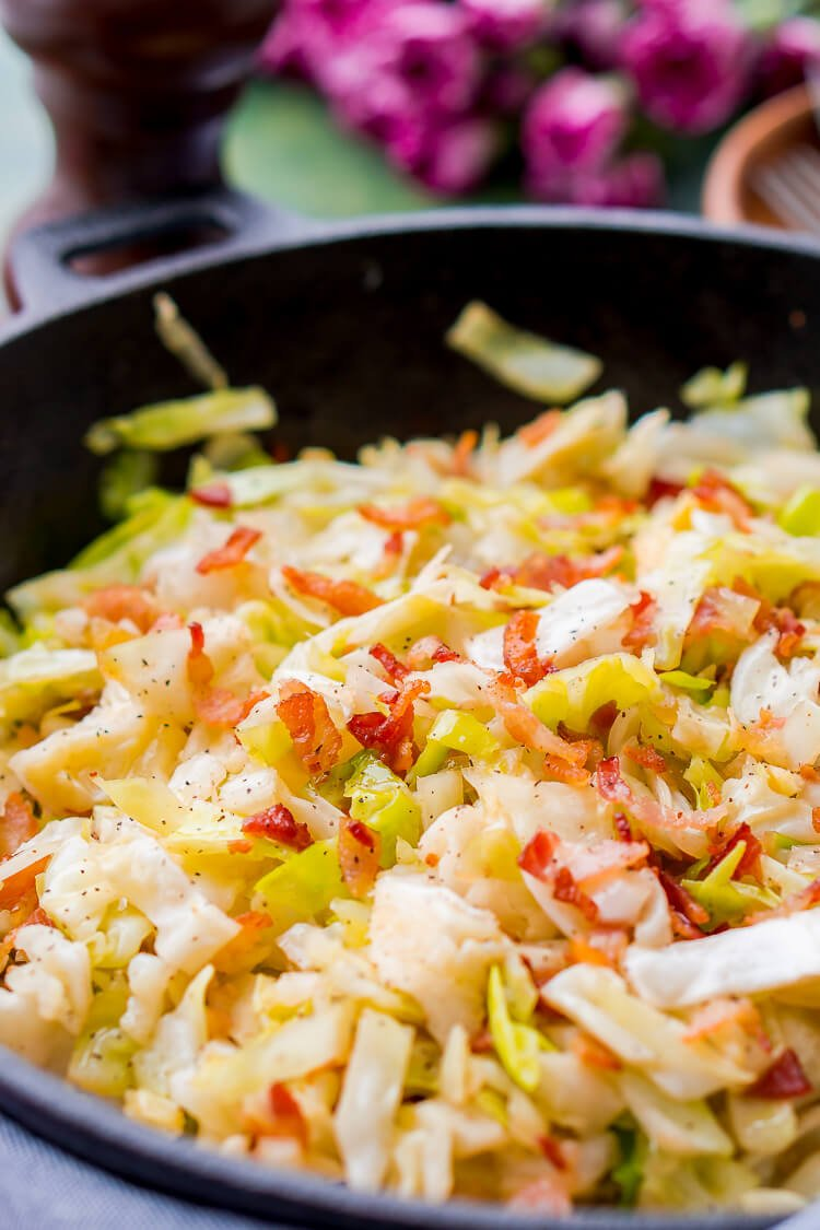 Irish Fried Cabbage is a simple recipe that's pan fried in bacon grease and loaded up with bacon pieces and onion and seasoned with brown sugar, salt, and pepper.