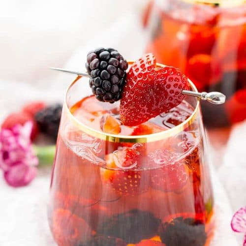 Rosé Berry Sangria is the perfect batch cocktail for Valentine's Day, Bridal Showers, and more! Made with rosé wine, Chambord, blackberry brandy, lemon-lime soda, and fresh berries!