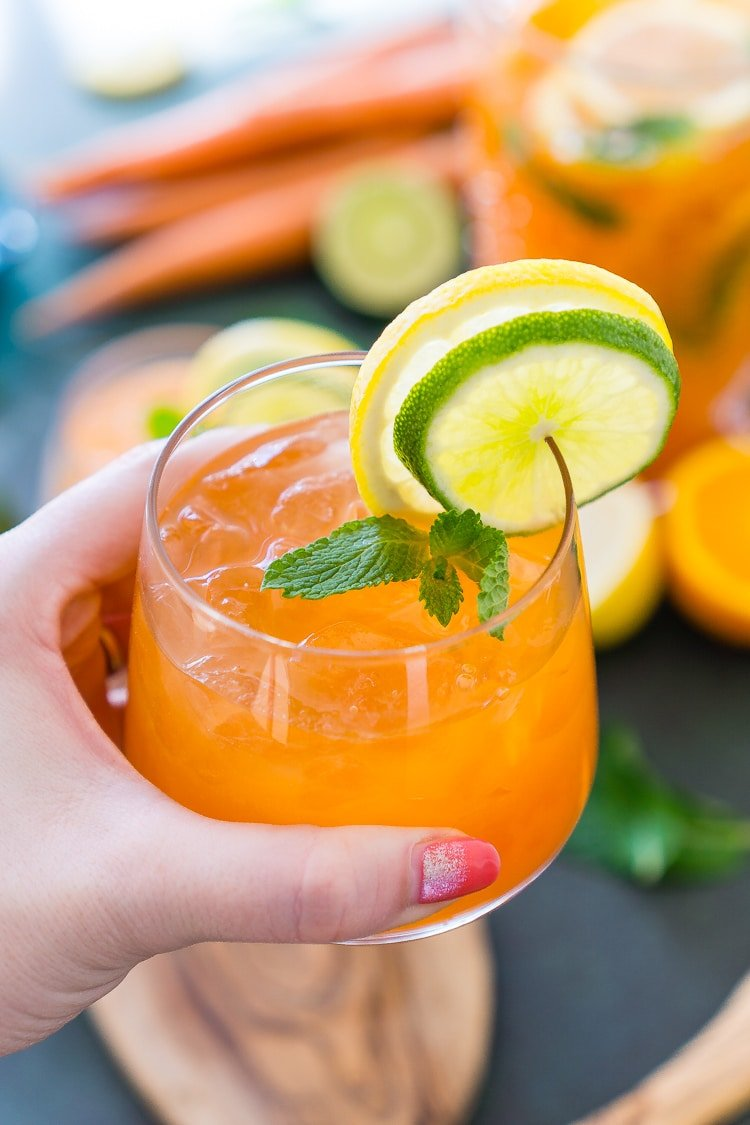 This Carrot Orange Punch is the perfect drink for spring, an easy mix of juice, soda, and fruit slices. It only takes 5 minutes to make and you can add alcohol if you want for a boozy punch!