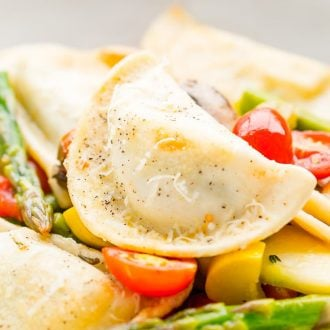 This Garden Vegetable Pierogy Primavera is a simple and delicious dinner recipe loaded with pan seared Feta & Spinach Pierogies and fresh veggies.