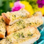 This Parmesan Garlic Bread is the perfect side for Bertolli's Frozen Chicken Florentine. A quick and easy recipe loaded with herbs, butter, and Parmesan cheese that can be whipped up in minutes!
