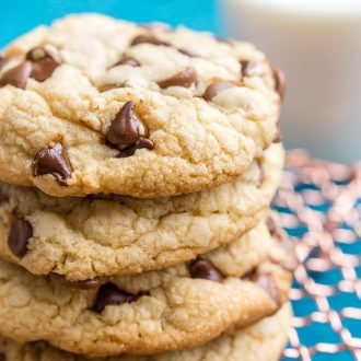 Close up photo of a stack of chocolate chip cookies.