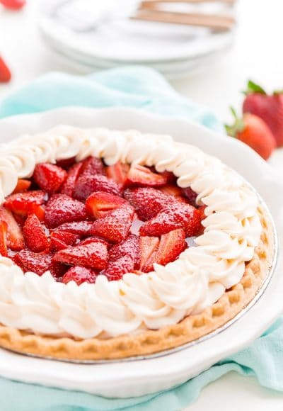 This Fresh Strawberry Margarita Pie is made with fresh, ripe strawberries, smooth Altos Tequila, and a few other simple ingredients for a boozy summertime dessert!
