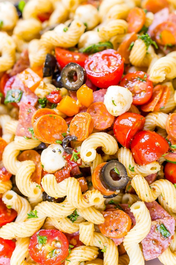Antipasti Pasta Salad recipe is loaded with veggies, cheeses, herbs, and meats and coated in a simple balsamic and olive oil dressing.