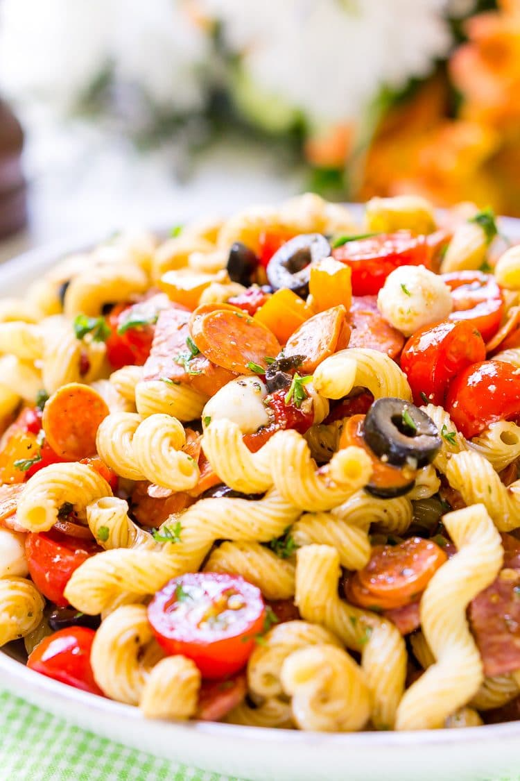 Antipasti Pasta Salad is loaded with veggies, cheeses, herbs, and meats and coated in a simple balsamic and olive oil dressing. Perfect for large get-togethers like BBQs and potlucks!