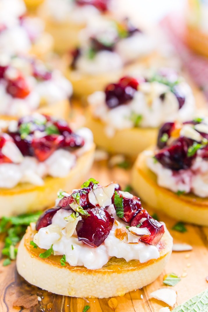 This Cottage Cheese & Cherry Crostini is a fresh and delicious appetizer recipe. Toasted bread topped with silky cottage cheese, cherries, almonds, honey, and mint!