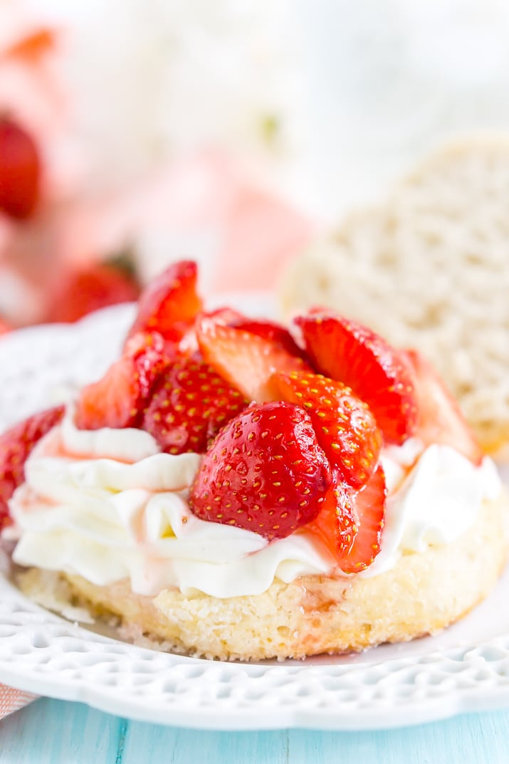 This Easy Strawberry Shortcake recipe is made with fresh strawberries, homemade whipped cream, and a delicious sugar biscuit for a classic summer dessert!