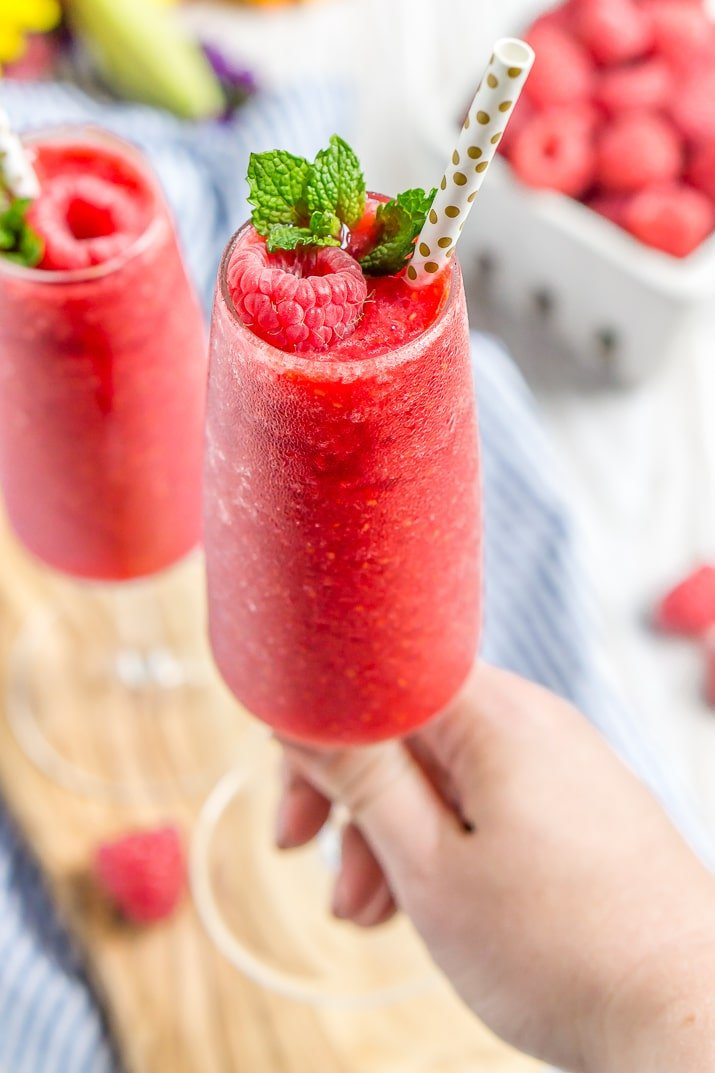 These Raspberry Champagne Slushies are made with just 4 ingredients in 5 minutes and are a fun way to celebrate summer, bridal showers, and even the New Year!