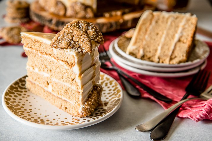Seasonal and comforting, this Boozy Bourbon Caramel Spice Cake is full of fall flavors, covered in a caramel bourbon cream cheese buttercream, and garnished with your favorite gingersnap cookies!